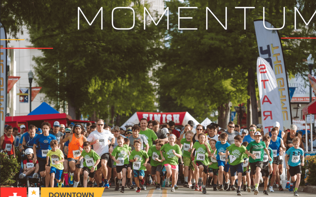 MOMENTUM Downtown Lafayette Annual Report 2019 (picture of runners at the start line of a race)